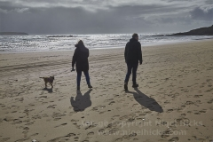 Walking on the beach, at Bigbury-on-Sea, Devon, Great Britain.