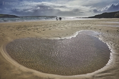 Low tide pool on the beach, at Bigbury-on-Sea, Devon, Great Britain.
