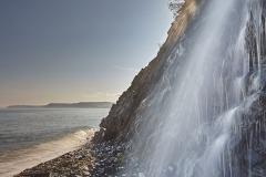 A beachside waterfall at Buck's Mill, near Clovelly, Devon, Great Britain.