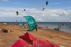 Kite-surfing and windsurfing at Exmouth, Devon, Great Britain.