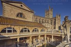 The main pool at the Roman Baths, with Bath Abbey behind, Bath, Great Britain.