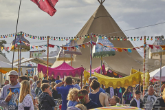 Crowds and teepee at Camp Bestival 2021. 31st July 2021. Lulworth, Dorset, Great Britain.