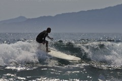 Surfing outside Kapuluan Vista Resort, at Blue Lagoon Beach, Pagudpud, Ilocos Norte, Luzon, Philippines.