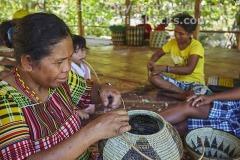 A Mangyan woman weaving a basket, near Talipanan, Puerto Galera, Mindoro, Philippines.