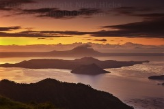 Dawn over Taal Lake and Taal volcano, seen from Taal Vista Hotel, Tagaytay, Calabarzon, Luzon, Philippines.
