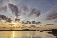 Sunset over Bryher, seen from Appletree Bay, on Tresco, Isles of Scilly, Great Britain.