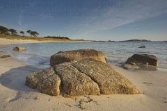 Rocks on the shoreline in Pentle Bay, Tresco, Isles of Scilly, Great Britain.