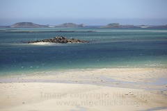 A low tide view across Pentle Bay, on Tresco, across to the Eastern Isles, Isles of Scilly, Great Britain.
