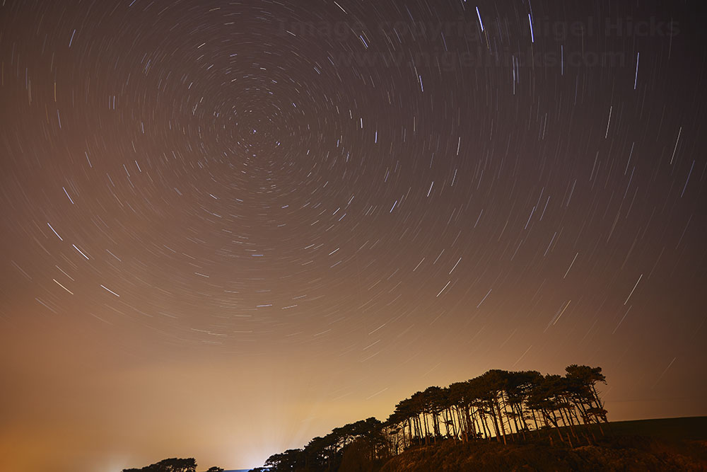 Star trails over the estuary of the River Otter, Devon. Low light photography workshop.