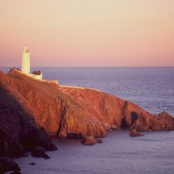 Sunset lighthouse coastal landscape greetings card