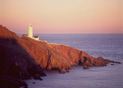 Sunset lighthouse coastal landscape greetings card