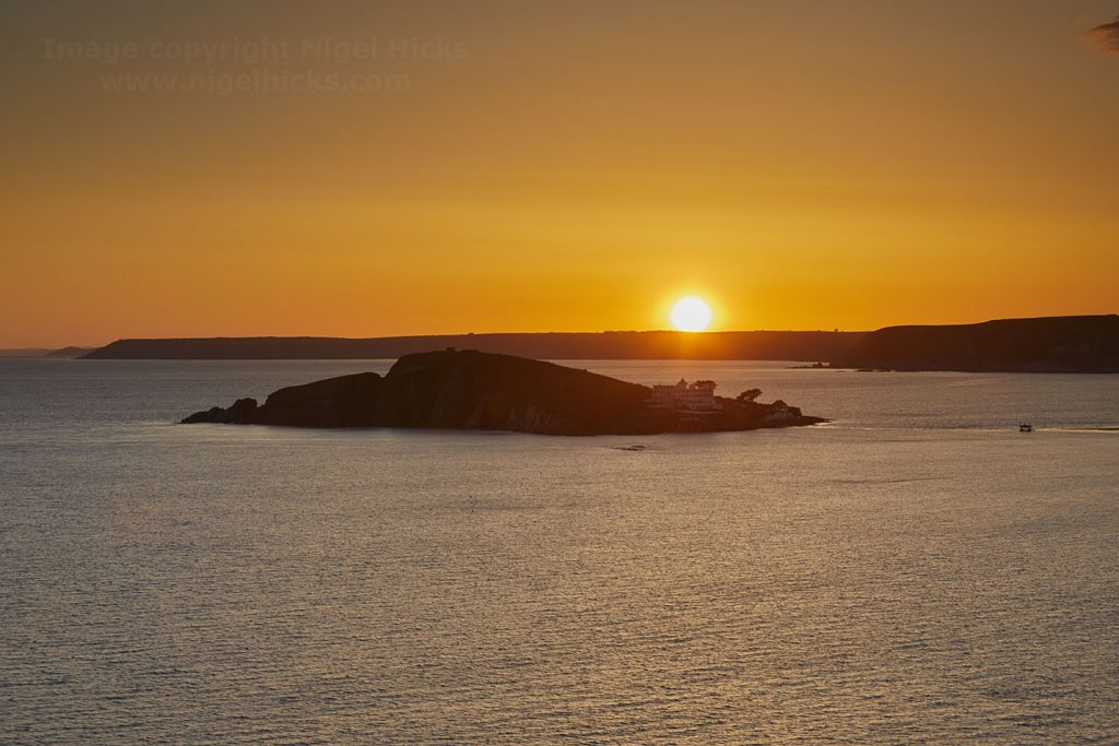 Sunset over Burgh Island and the south Devon coast.