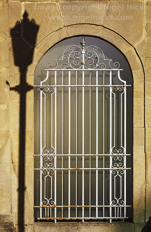 Window detail and street light shadow, in Bath, Somerset, Great Britain. Travel and architectural photography course.
