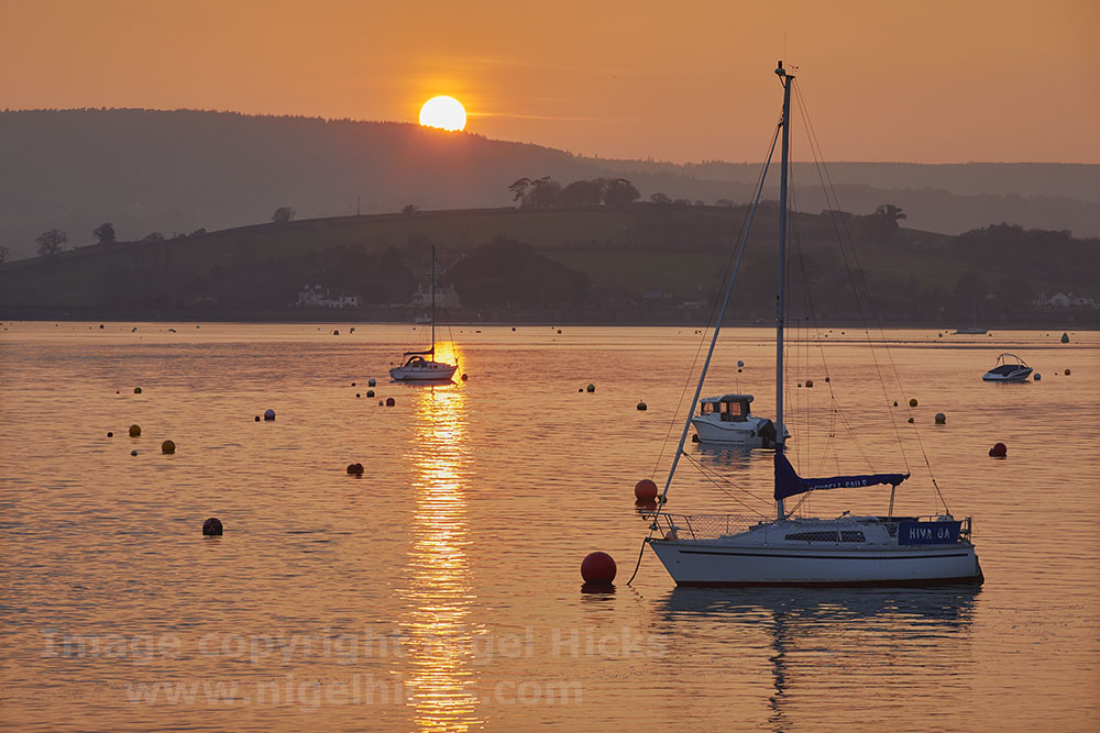 Low light photography: sunset over the River Exe, at Exmouth, Devon, Great Britain.