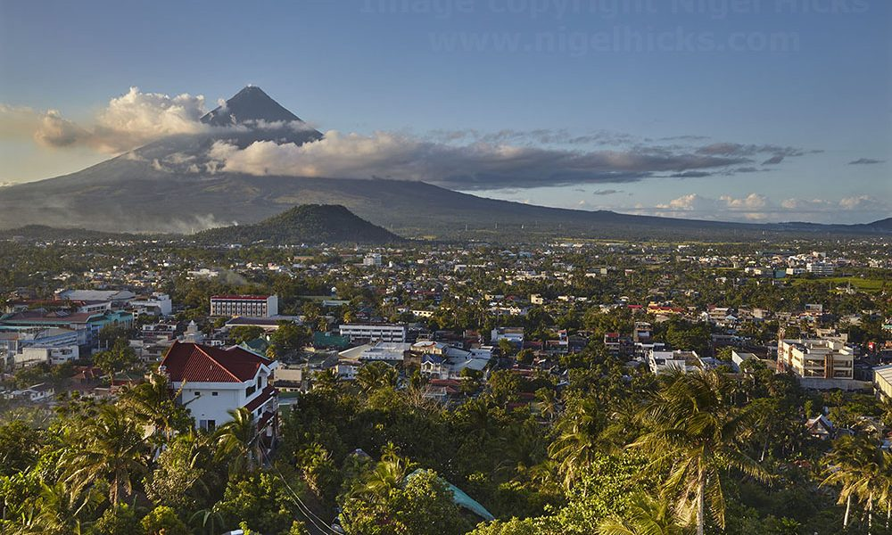 Mt Mayon and the city of Legazpi, Luzon, the Philippines.